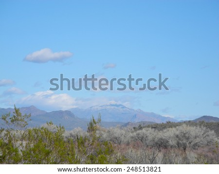 A beautiful winter day, looking out over the far hills of Tonto National Forest, Arizona.  - stock photo