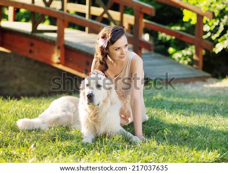 A beautiful woman and his dog - stock photo