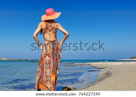 A beautiful woman at the beach Elafonisos of Creta, Greece