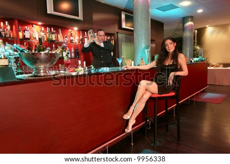 a beautiful woman at the cocktail bar - stock photo