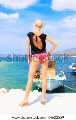 A beautiful woman at the sea in Greece