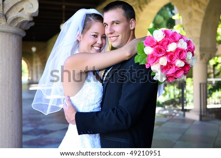 A beautiful woman bride and handsome man groom at church during wedding - stock photo