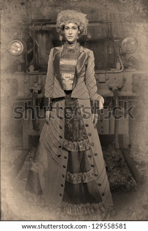 A beautiful woman dressed as a rich woman in the early 1910's. - stock photo