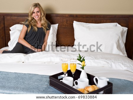 A beautiful woman has breakfast in bed