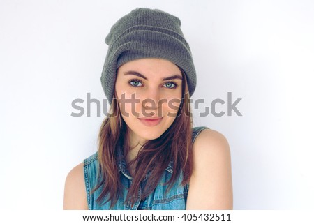 A beautiful woman in a gray beanie