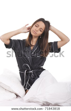 a beautiful woman in bed waking up - stock photo