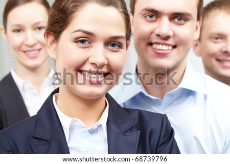 A beautiful woman leader with her colleagues - stock photo