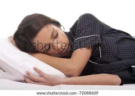 a beautiful woman  lying in bed sleepy - stock photo