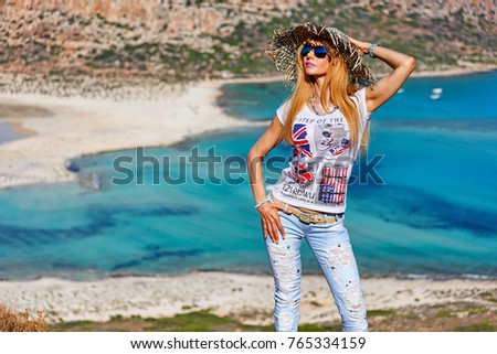A beautiful woman over the beach Balos of Creta, Greece