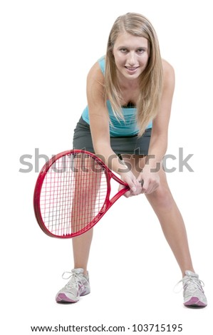 A beautiful woman playing the sports game of tennis - stock photo
