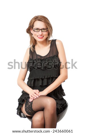 a beautiful woman posing and smiling coquettishly. - stock photo