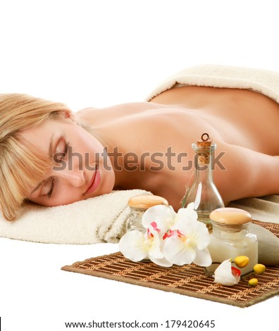 A beautiful woman relaxing in a spa center, isolated on white