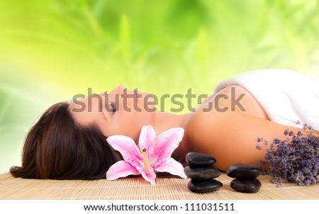 A beautiful woman relaxing in spa - stock photo