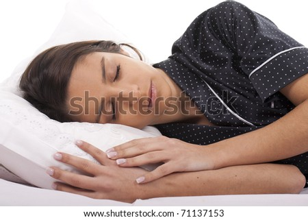 a beautiful woman resting in bed and sleeping - stock photo