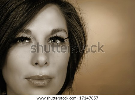 a beautiful woman's face in close up - stock photo