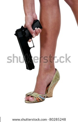 A beautiful woman shooting herself in the foot.