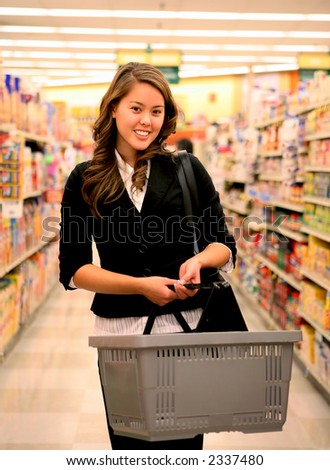 A beautiful woman shopping in the grocery store - stock photo