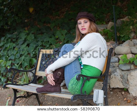 a beautiful woman sitting ina a couch with her feet on the couch,too - stock photo