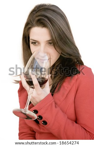 a beautiful woman smell a red glass wine - stock photo