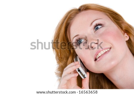 A beautiful woman smiles as she talks on her cellphone