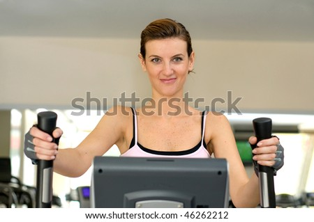 A beautiful woman smiling and work out at Gym