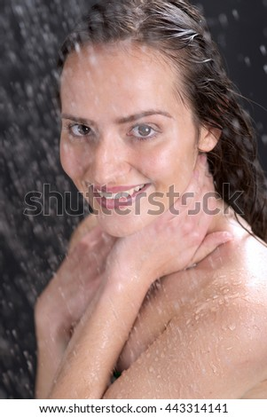 a beautiful woman standing at the shower - stock photo