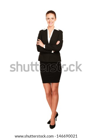 A beautiful woman standing with her arms crossed, isolated on white background - stock photo