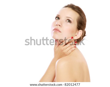 A beautiful woman touching her face, isolated on white - stock photo
