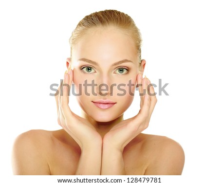 A beautiful woman touching her face, portrait isolated on white background - stock photo