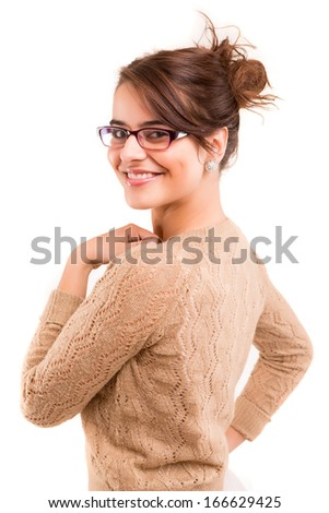 A beautiful woman wearing glasses, posing isolated over white
