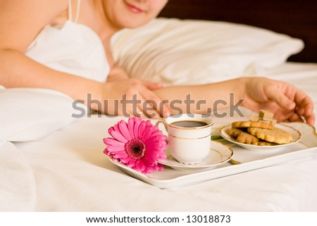 a beautiful woman with breakfast in bed - stock photo