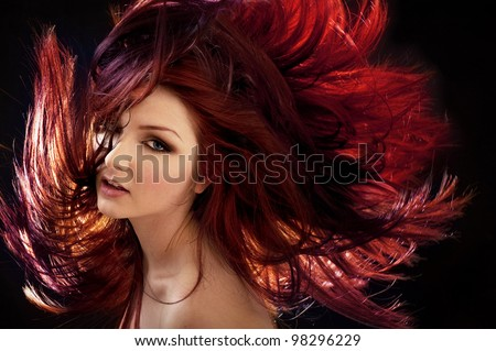 A beautiful woman with crazy hair - stock photo