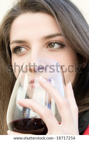 a beautiful woman with glass red wine - stock photo