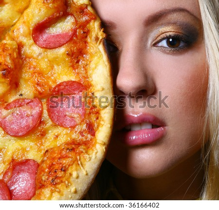 a beautiful woman with make-up and pizza - stock photo
