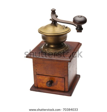 A beautiful wooden pepper or salt mill. Studio photo on  white background