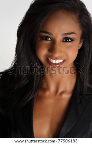 a beautiful young african american woman with a pretty smile