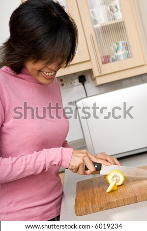 A beautiful young asian women preparing lemons in the kitchen