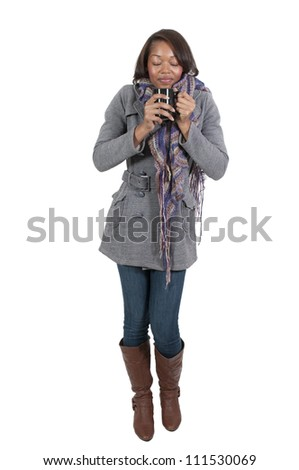 A beautiful young black woman drinking coffee. - stock photo
