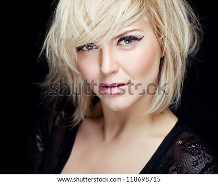 A beautiful young blond woman portrait studio. Staging adorable model. Makeup. Hairstyle. - stock photo