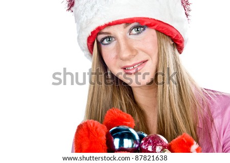 a beautiful young blonde girl dressed as Santa Claus with Christmas toys in the hands, isolated over white