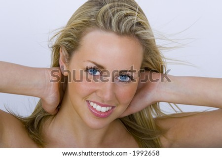 A beautiful young blonde woman smiles for the camera