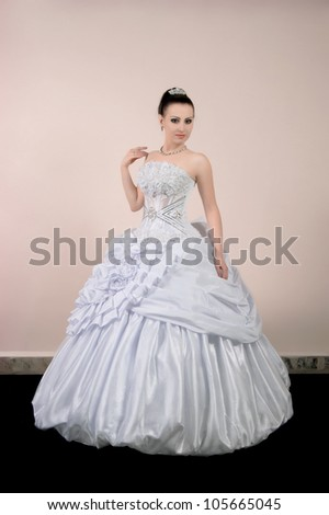 a beautiful young bride dressed - stock photo