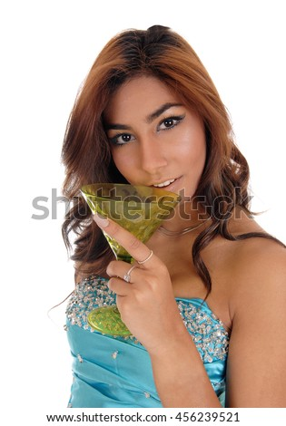 A beautiful young brunette woman in a blue evening dress holding a