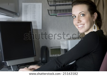 A beautiful young businesswoman in the office. - stock photo