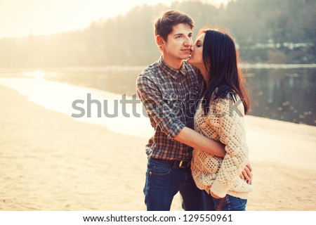 a beautiful young couple embracing - stock photo