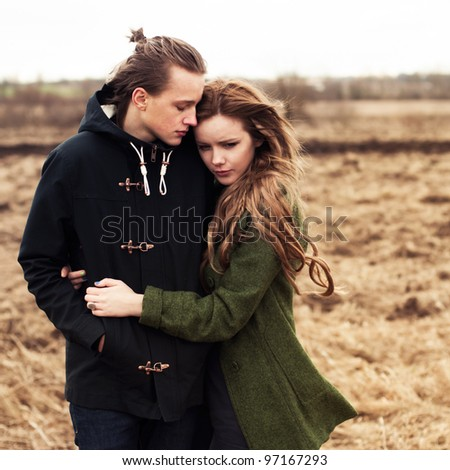 a beautiful young couple embracing