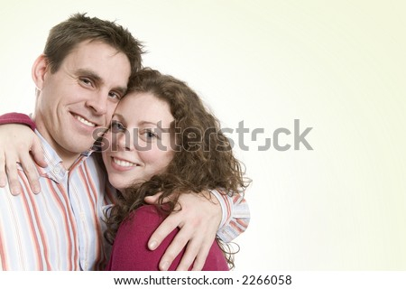 A beautiful young couple enjoy themselves together - stock photo