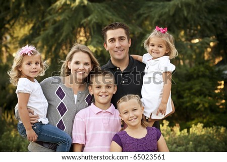A Beautiful Young Family Portrait - stock photo