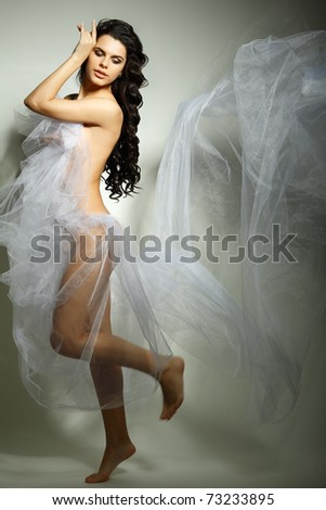 a beautiful young girl is in a bridal veil