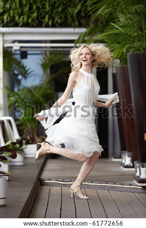 A beautiful young girl jumping in a restaurant - stock photo